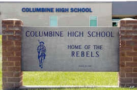 Signs outside Columbine High School, June 13, 2019, in Littleton, Colo. The school district was considering the demolition of Columbine, the scene of a mass assault more than 20 years ago, and rebuilding the current school.