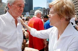 Sen. Ed Markey, D-Mass., left, talks with Sen. Elizabeth Warren, D-Mass. during the Rally Against Separation Saturday, June 30, 2018, in . (AP Photo/Winslow Townson)