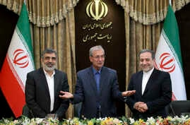 From left to right, spokesman for Iran's atomic agency Behrouz Kamalvandi, Iran's government spokesman Ali Rabiei and Iranian Deputy Foreign Minister Abbas Araghchi, attend a press briefing in Tehran, Iran, Sunday, July 7, 2019. The deputy foreign…