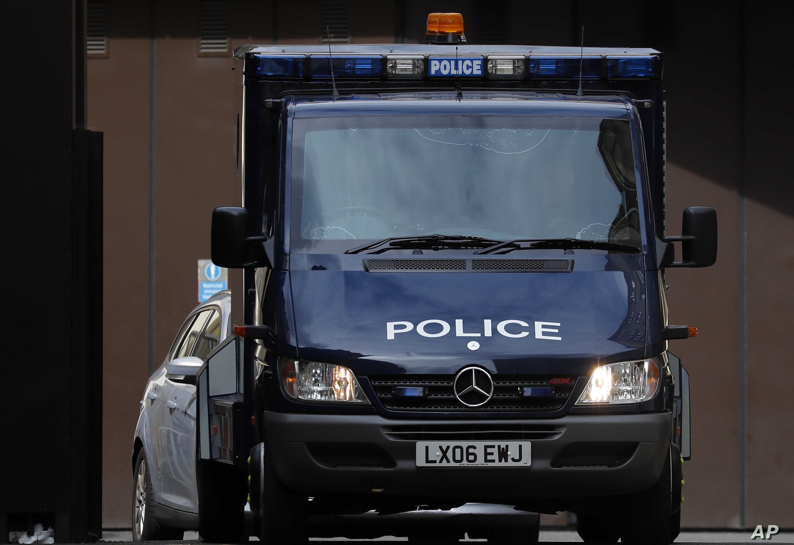 An armoured police van believed to carry Salih Khater drives out of the car park at Westminster Magistrates court in London, Monday, Aug. 20, 2018. A driver whose car collided with several people before crashing outside Britain's Parliament has been…