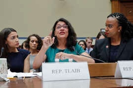 Rep. Rashida Tlaib, D-Mich., center, gestures while testifying before the House Oversight Committee hearing on family separation and detention centers, Friday, July 12, 2019 on Capitol Hill in Washington. Also sitting at the panel with Tlaib are Rep…