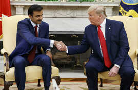 President Donald Trump shakes hands with Qatar's Emir Sheikh Tamim Bin Hamad Al-Thani in the Oval Office of the White House, Tuesday, July 9, 2019, in Washington. (AP Photo/Evan Vucci)