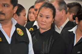 FILE - In this Oct. 31, 2018 photo provided by Peru's Supreme Court, Peru's former first daughter Keiko Fujimori stands in court where a judge ruled that she should be detained ahead of her trial for running a criminal network.
