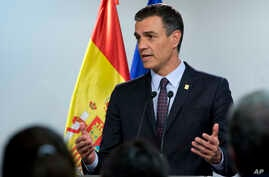 FILE - In this file FILE - In this file photo dated July 2, 2019, Spanish Prime Minister Pedro Sanchez speaks during a media conference during an EU summit in Brussels. hoto dated Tuesday, July 2, 2019, Spanish Prime Minister Pedro Sanchez speaks during a media conference during an EU summit in Brussels.  It is announced Friday July 19, 2019, that Sanchez is ready to create a coalition…
