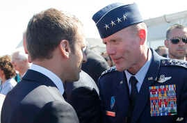 FILE - In this June 19, 2017 file photo, French President Emmanuel Macron, meets with Gen. Tod Wolters, while visiting the Paris Air Show in Le Bourget, north of Paris.