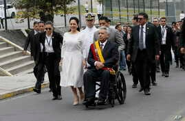 Ecuador' s President Lenin Moreno, center right, and his wife Rocio Gonzalez arrive at the National Assembly to deliver his State of Nation speech in Quito, Ecuador, Friday, May 24, 2019. (AP Photo/Dolores Ochoa)
