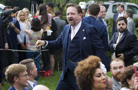 Radio host Sebastian Gorka, who was seated as a guest, moves to confront a journalist after President Donald Trump spoke about the 2020 census in the Rose Garden of the White House, Thursday, July 11, 2019, in Washington. (AP Photo/Alex Brandon)