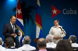 Russian Foreign Minister Sergey Lavrov, left, talks during a joint press conference with Cuba's Minister of Foreign Affairs Bruno Rodriguez, in Havana, Cuba, July 24, 2019.