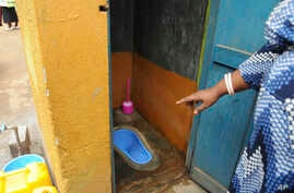 In this photo of Wednesday July 10, 2019, the head of the School of Motherlove Infants School Faridah Hussein Lwanga, displays Sanpants, the new technology used in toilets so they do not smell as part of a campaign encouraging people to keep their…