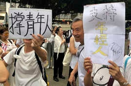 "Elderly Hong Kong residents with posters that read ""Support young people"" during a march in Hong Kong on Wednesday, July 17, 2019. Some 2,000 Hong Kong senior citizens, including a popular actress, marched Wednesday in a show of support for youths…"