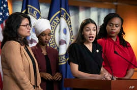 U.S. Rep. Alexandria Ocasio-Cortez, D-N.Y., speaks as, from left, Rep. Rashida Tlaib, D-Mich., Rep. Ilhan Omar, D-Minn., and Rep. Ayanna Pressley, D-Mass., listen during a news conference at the Capitol in Washington, Monday, July 15, 2019…