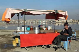 FILE - In this Jan. 28, 2019 file photo, an Afghan street vendor waits for customers on the outskirts of Kabul, Afghanistan. In a Thursday, March 28, 2019 report the Special Inspector General for Afghan Reconstruction, a U.S. watchdog, said that…