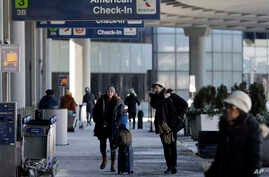 Passengers walk through Terminal 3 at O'Hare International Airport in Chicago, Thursday, Jan. 31, 2019. Chicago's polar vortex freeze makes it the coldest it's been since 1985, as Rockford breaks low temp record at minus 30. Disruptions caused by…