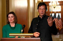 Pakistan's Prime Minister Imran Khan, right, speaks to the media with House Speaker Nancy Pelosi of Calif., Tuesday, July 23, 2019, on Capitol Hill in Washington. (AP Photo/Jacquelyn Martin)