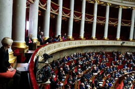 Visitors, top, and parliament members attend the questions to the government session at the National Assembly in Paris, Tuesday, Dec.4, 2018. The French government's decision to suspend fuel tax and utility hikes Tuesday did little to appease…