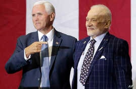 Vice President Mike Pence, left, points to Apollo 11 astronaut Buzz Aldrin during an event at the Kennedy Space Center in recognition of the Apollo 11 anniversary, Saturday, July 20, 2019, in Cape Canaveral, Fla. (AP Photo/John Raoux)