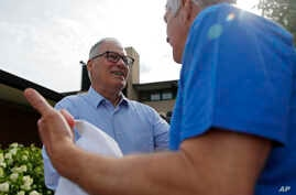 Democratic Presidential candidate Washington Gov. Jay Inslee meets with people at the Iowa State Fair, Saturday, Aug. 10, 2019, in Des Moines, Iowa. (AP Photo/John Locher)