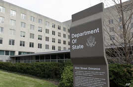 FILE - In this Dec. 15, 2014 file photo, the State Department in Washington. U.S. officials say the Trump administration is proposing deep cuts in funding for diplomacy and foreign aid to help pay for increased military spending.  (AP Photo/Luis M…