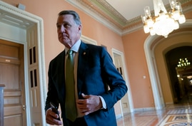 Sen. David Perdue, R-Ga., returns to the chamber following a meeting with fellow Republicans, at the Capitol in Washington, Tuesday, April 30, 2019. (AP Photo/J. Scott Applewhite)