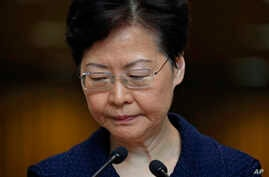"""Hong Kong Chief Executive Carrie Lam pauses during a press conference in Hong Kong Tuesday, Aug. 20, 2019. Lam said she's setting up a """"communication platform"""" to resolve differences in the Chinese city, which has been wracked by months of chaotic…"""