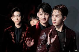 Members of South Korean music band GOT7 pose for photos on the red carpet of the Mnet Asian Music Awards (MAMA) in Hong Kong, Friday, Dec. 14, 2018. (AP Photo/Kin Cheung)