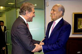 Pakistan's Foreign Minister Shah Mehmood Qureshi, left, receives U.S. envoy Zalmay Khalilzad in Islamabad, Aug. 1, 2019. Khalilzad had hinted that a peace agreement could be reached in the next round of talks with the Taliban.