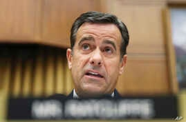 FILE - In this Wednesday, July 24, 2019, file photo, Rep. John Ratcliffe, R-Texas., questions former special counsel Robert Mueller as he testifies before the House Intelligence Committee hearing on his report on Russian election interference, on…