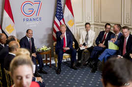 President Donald Trump speaks during a bilateral meeting with Egyptian President Abdel Fattah al-Sissi, left, at the G-7 summit in Biarritz, France, Monday, Aug. 26, 2019. (AP Photo/Andrew Harnik)