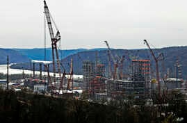 FILE - This April 18, 2019 file photo shows part of a petrochemical plant being built on the banks of the Ohio River in Monaca, Pa., for the Royal Dutch Shell company.