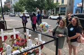 Sabrina Herman, gesturing, visits a makeshift memorial  on Wednesday, Aug. 14, 2019, outside Ned Peppers nightclub in the Oregon District entertainment neighborhood where on Aug. 4 a gunman killed nine people, in Dayton Ohio. Herman, 41, of Dayton,…