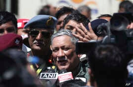 Indian Army Chief Gen. Bipin Rawat speaks to the media after flying in a Tejas, an Indian Air Force light combat aircraft, on the second day of Aero India 2019 at Yelahanka air base in Bangalore, India, Thursday, Feb. 21, 2019. Aero India is a…
