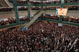 "Local residents sing a theme song written by protesters ""Glory be to thee"" at a shopping mall in Hong Kong Wednesday, Sept. 11, 2019. Hong Kong Chief Executive Carrie Lam reassured foreign investors Wednesday that the Asian financial hub can rebound…"
