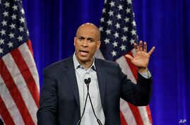 Democratic presidential candidate Sen. Cory Booker, D-N.J., gestures while speaking at the Democratic National Committee's summer meeting Friday, Aug. 23, 2019, in San Francisco. More than a dozen Democratic presidential hopefuls are making their…