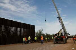 Workers break ground on new border wall construction about 20 miles west of Santa Teresa, New Mexico, Aug. 23, 2019. The wall visible on the left was built in 2018 with money allocated by Congress, while the new construction is funded by money…