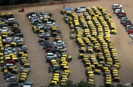 A rickshaw puller pedals past rows of auto-rickshaws and taxis parked during a public transport strike in New Delhi, India, Thursday, Sept. 19, 2019. Commuters in the Indian capital are facing problems as a large section of the public transport,…