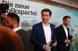 Former Austrian chancellor and top candidate of the Austrian People's Party, OEVP, Sebastian Kurz, center, arrives for a closing rally ahead of federal elections in Vienna, Austria, Saturday, Sept. 28, 2019. (AP Photo/Matthias Schrader)