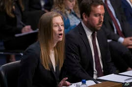 Monika Bickert, head of global policy management at Facebook, joined at right by Nick Pickles, public policy director for Twitter, testifies before the Senate Commerce, Science and Transportation Committee during a hearing on how internet and social…