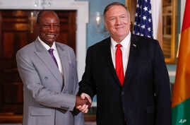 Secretary of State Mike Pompeo, right, shakes hands with Guinean President Alpha Conde, left, at the State Department in Washington, Friday, Sept. 13, 2019. (AP Photo/Pablo Martinez Monsivais)