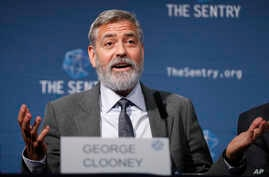 """US actor and activist George Clooney speaks at a press conference about South Sudan in London, Thursday, Sept. 19, 2019. The largest multinational oil consortium in South Sudan is """"proactively participating in the destruction"""" of the country, the…"""