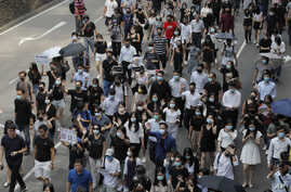 Protesters march during a flash mob protest in Hong Kong, on Friday, Oct. 11, 2019. Hundreds of masked protesters gathered at…