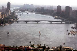 In this Oct. 6, 2017 photo, boats sail on the Nile River in Cairo, Egypt. Tensions between Egypt and upstream Nile basin…