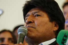 Bolivian President Evo Morales speaks to supporters at the presidential palace in La Paz, Bolivia, after a first round…