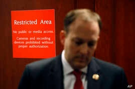 A sign marks a door to a secure area behind Rep. Lee Zeldin, R-N.Y., as he speaks with members of the media after Deputy…