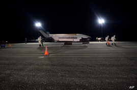 In this Oct. 27, 2019 photo released by the U.S. Air Force, the Air Force's X-37B successfully lands at NASA's Kennedy Space…