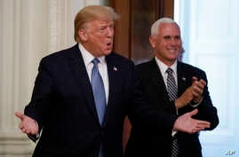 President Donald Trump, and Vice President Mike Pence arrive to at the Young Black Leadership Summit at the White House in…