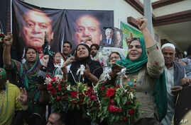 Supporters of Pakistani former Prime Minister Nawaz Sharif celebrate the release of their leader, outside a hospital where…