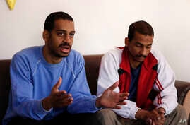 """FILE - In this March 30, 2019, photo, Alexanda Amon Kotey, left, and El Shafee Elsheikh, who were allegedly among four British jihadis who made up a brutal IS cell dubbed """"The Beatles,"""" speak with The Associated Press"""