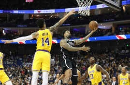 Brooklyn Nets' Wilson Chandler goes to the basket against Los Angeles Lakers' Danny Green, left, during the Nets' 114-111 preseason win in Shanghai, China, Oct. 10, 2019.