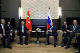 Russian President Vladimir Putin, center right, and Turkish President Recep Tayyip Erdogan , center left, speak during their…