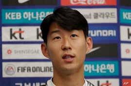 South Korean national soccer team player Son Heung-min answers a reporter's question upon his arrival after the soccer match…